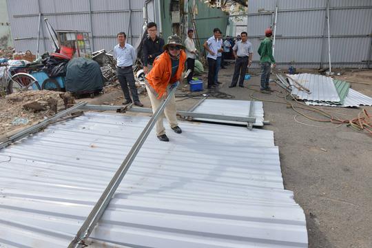 tháo dỡ 26 căn nhà ở chung cư Cô Giang