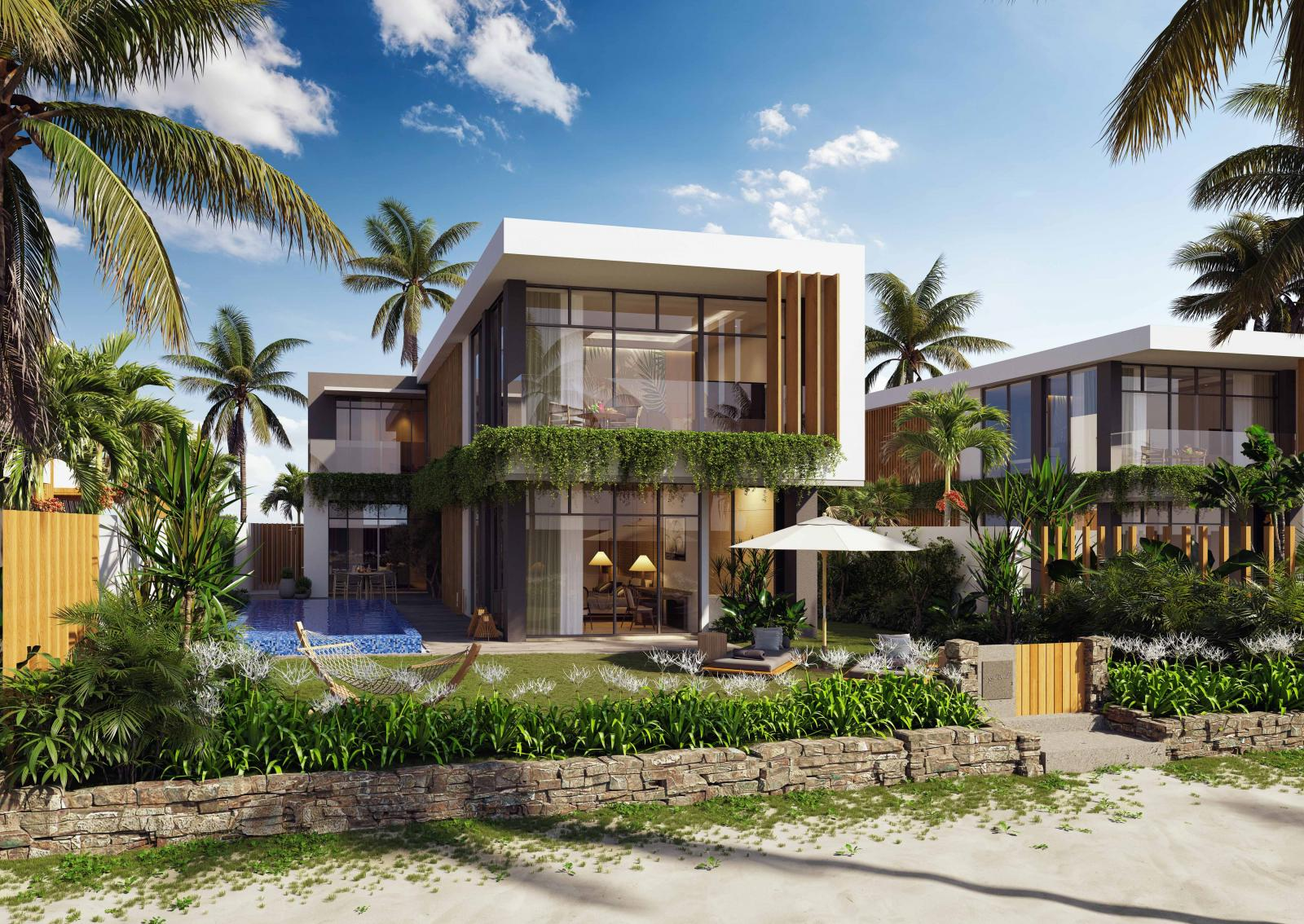 Một căn biệt thự biển có hồ bơi bên cạnh và xung quang có nhiều cây dừa