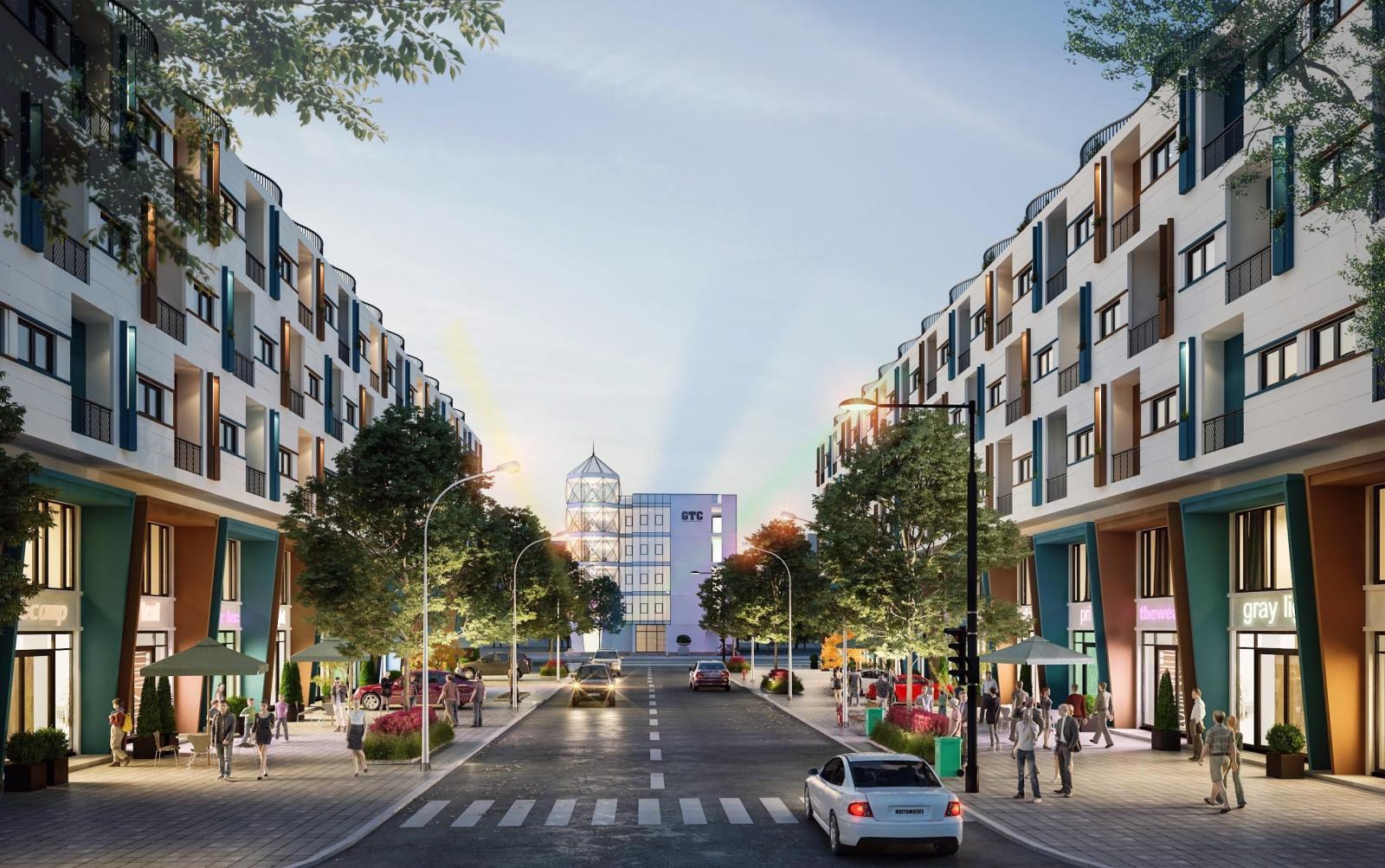 Một góc con đường với hai bên là dãy nhà thương mại với tone màu trắng xanh