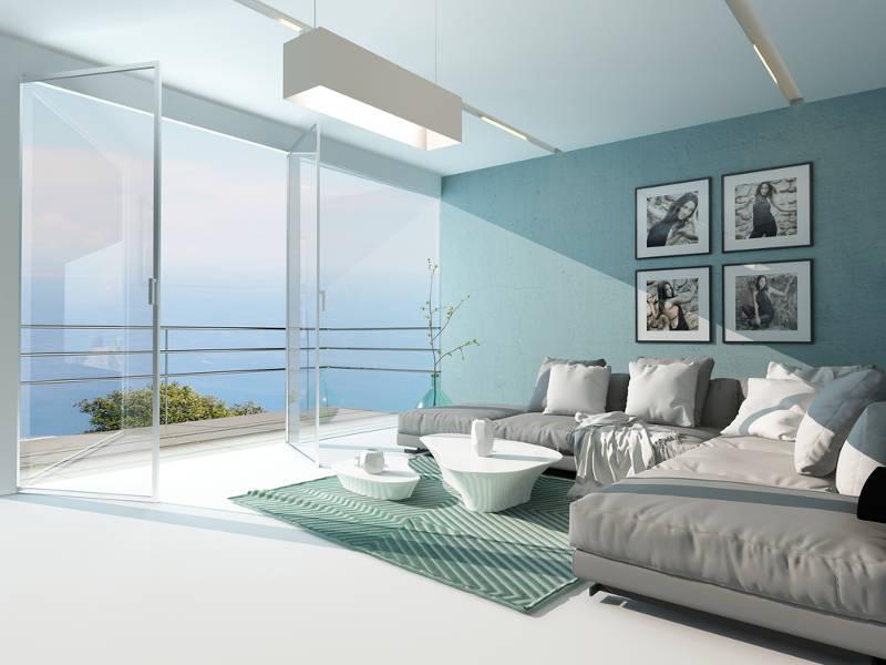 sofa màu xám trong căn phòng màu xanh