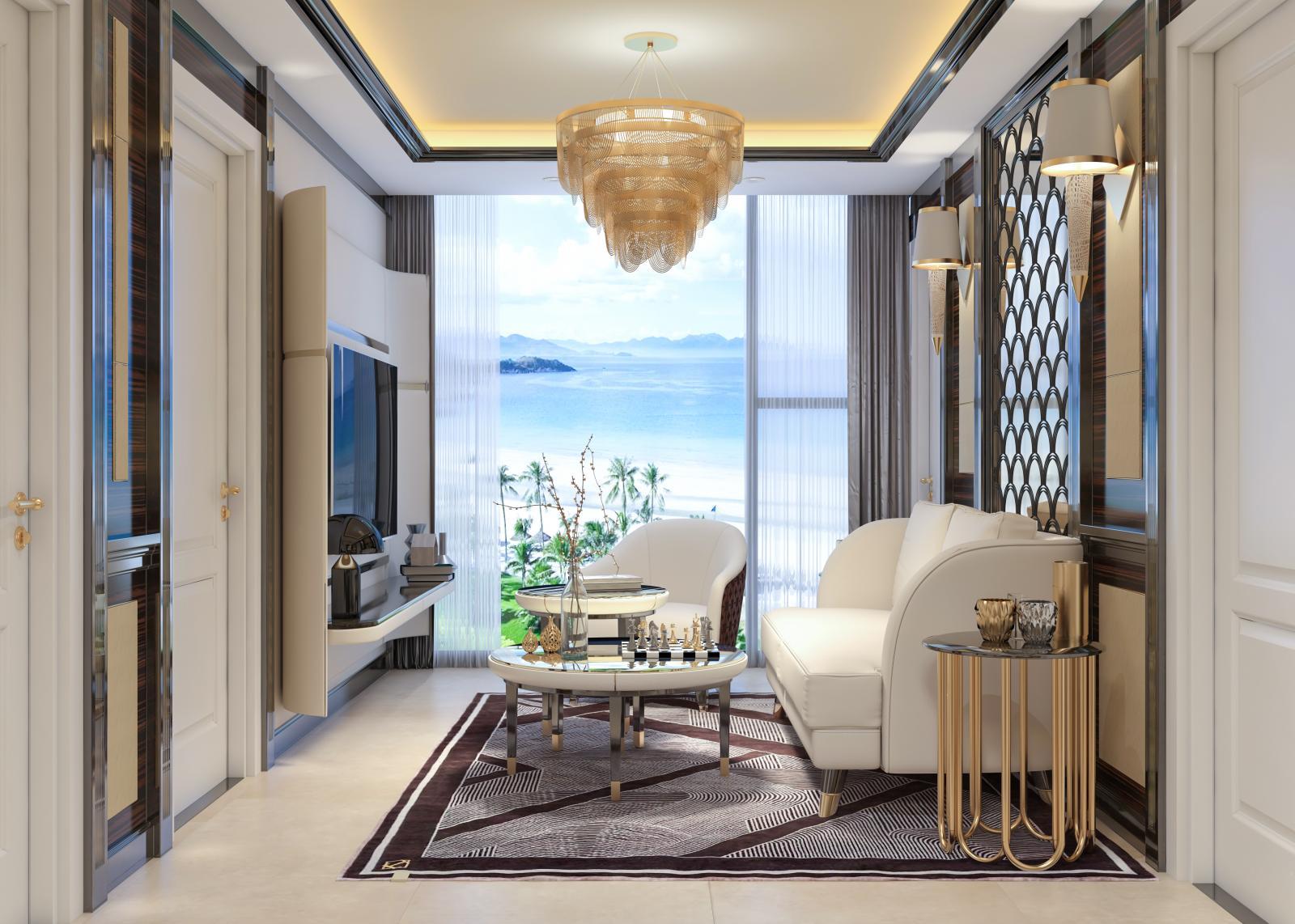 Một góc căn hộ với bộ bàn ghế màu kem kê sát ban công, view thẳng ra biển