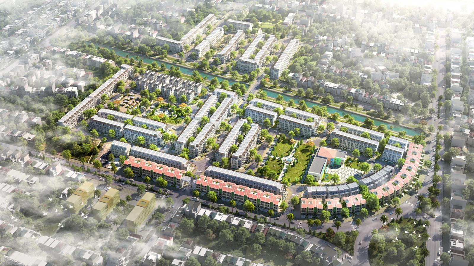 Dự án khu đô thị nhìn từ trên cao gồm nhiều dãy nhà cao tầng có nhiều cây xanh xen kẽ, cạnh đường