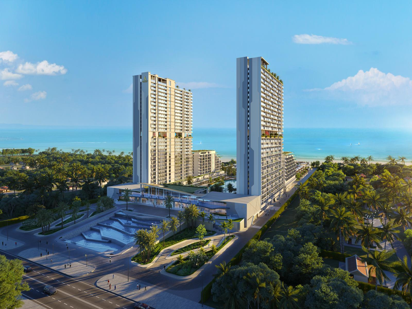 Hai tòa nhà cao tầng nằm song song nhau trên 1 vùng đất nhiều cây xanh gần bãi biển