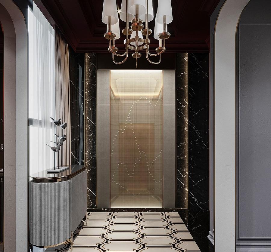 thang máy căn hộ nằm ở hành lang, phía trên có đèn chùm