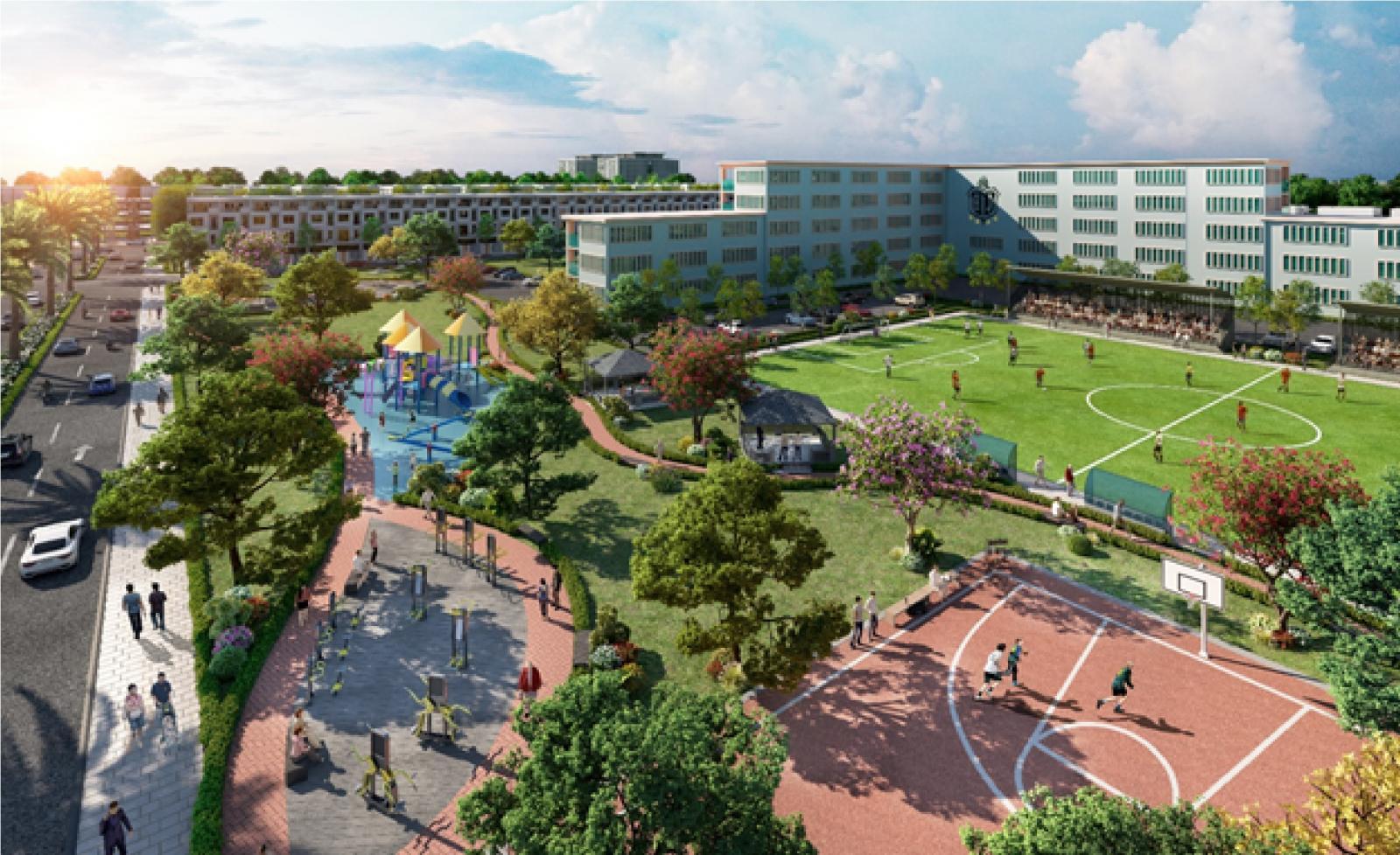 Khuôn viên một dự án bất động sản với nhiều cây xanh và một sân bóng
