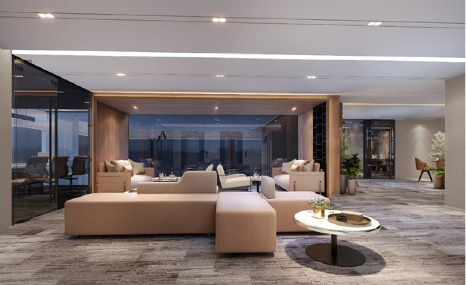 Khu tiếp khách với chiếc bàn tròn mặt kính, chiếc ghế sofa hình chữ L màu nâu nhạt