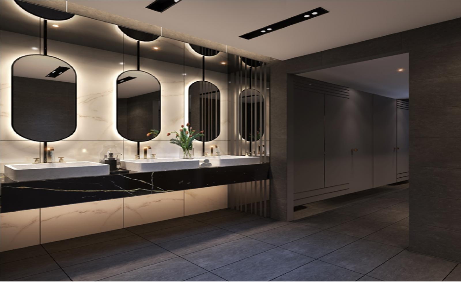 Một góc khu vệ sinh với bồn rửa tay và 4 chiếc gương treo tường hình bầu dục