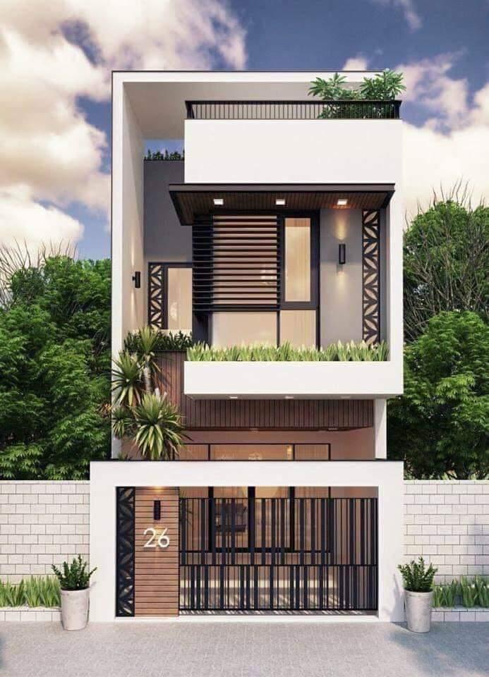 nhà phố 2 tầng sử dụng đường nét mạnh mẽ và các gam màu trắng, trung tính