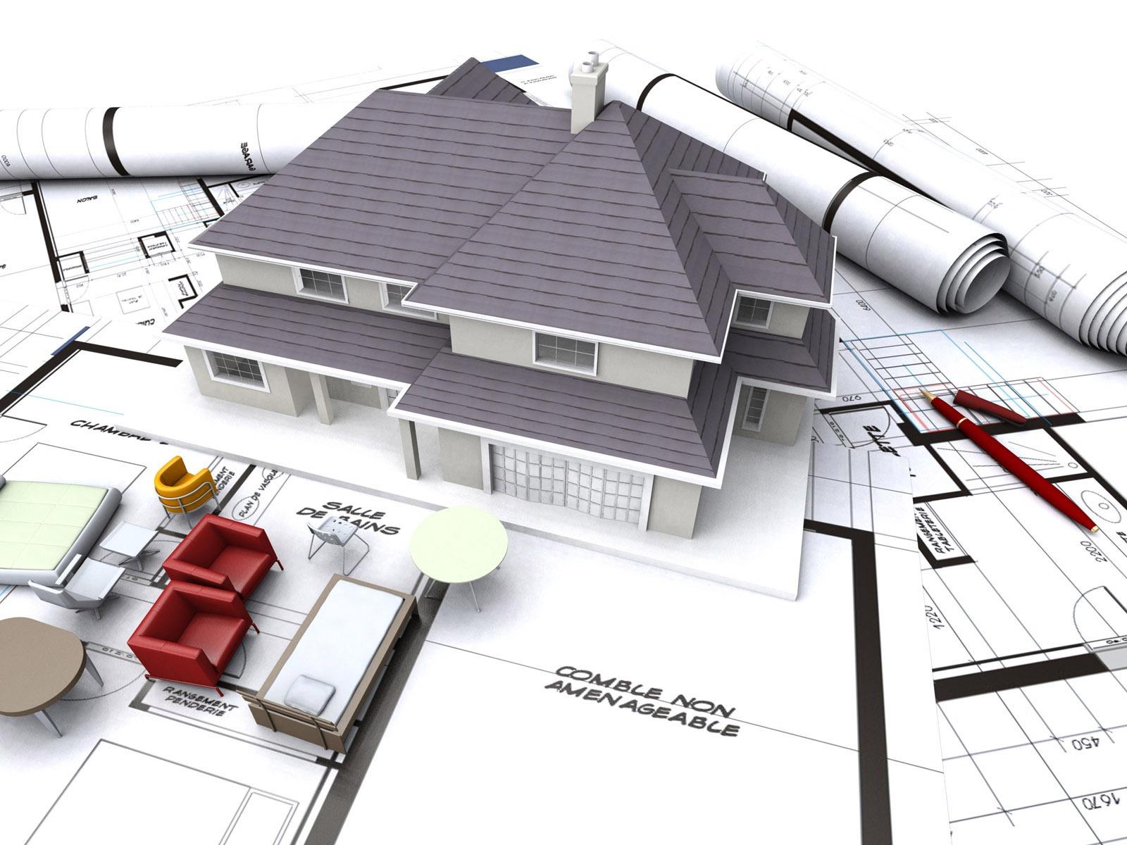 một ngôi nhà mô hình và nhiều giấy tờ, bản vẽ thiết kế