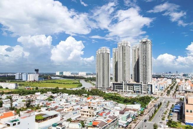một góc TP.HCM nhìn từ trên cao có nhiều nhà ở, xen kẽ đường lớn