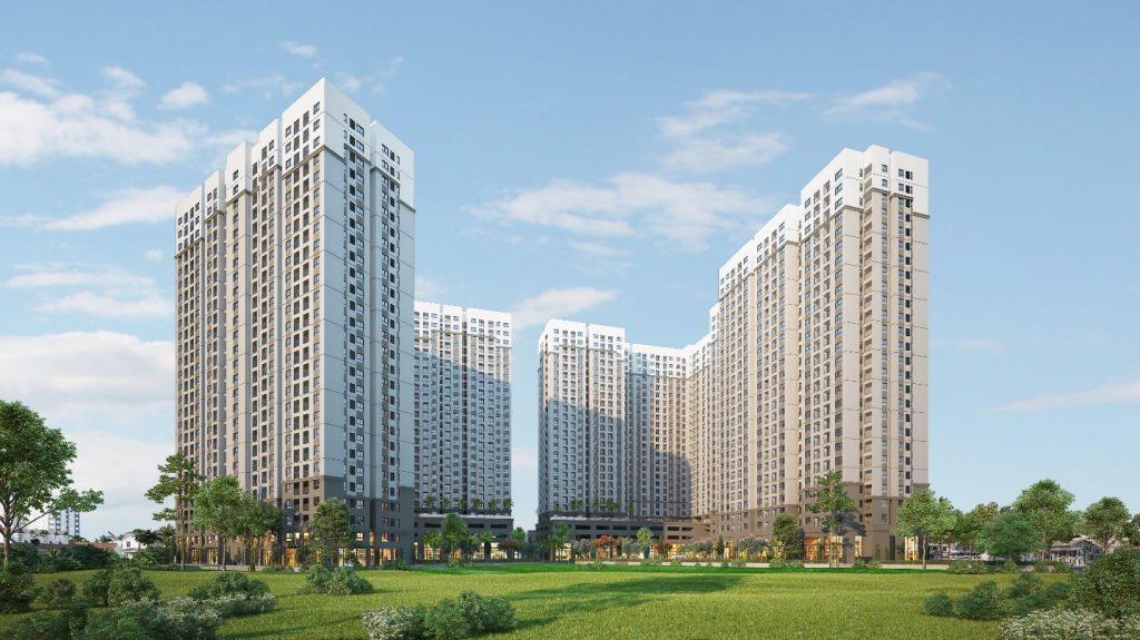 Ảnh chụp một dự án chung cư gồm nhiều khối nhà cao tầng xếp thành hình chữ U, bên dưới là khuông viên xanh.