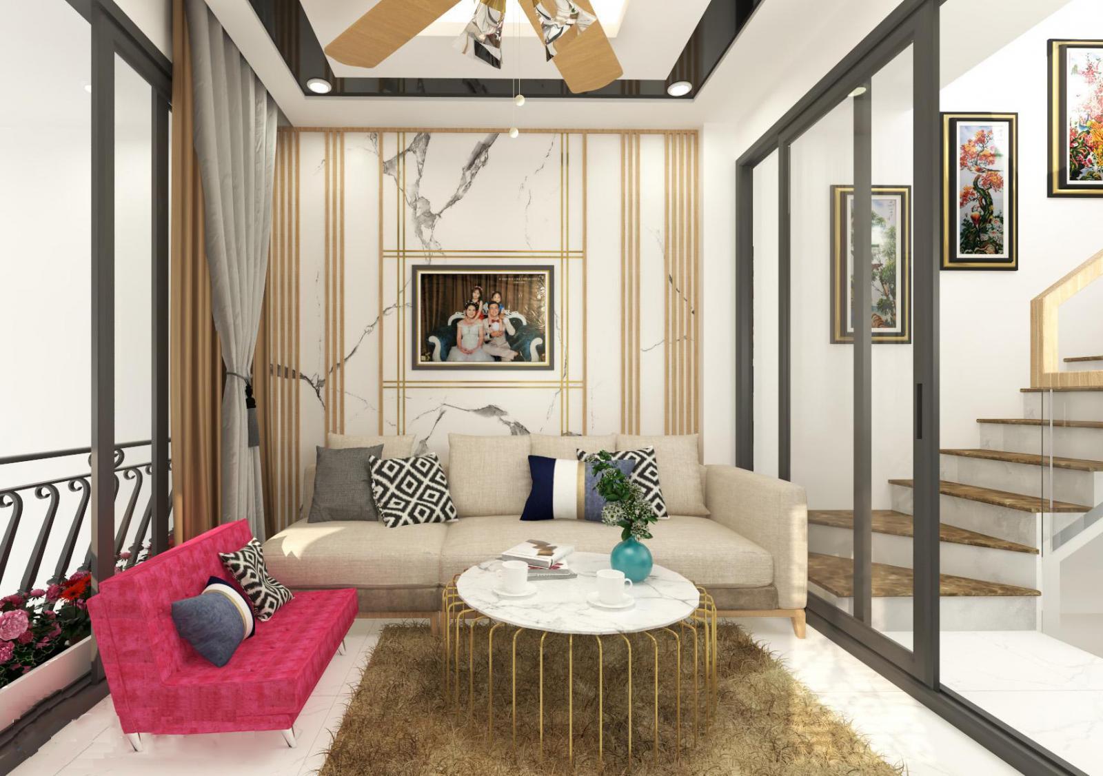Phòng khách diện tích nhỏ, có sofa, bàn, ảnh gia đình treo tường