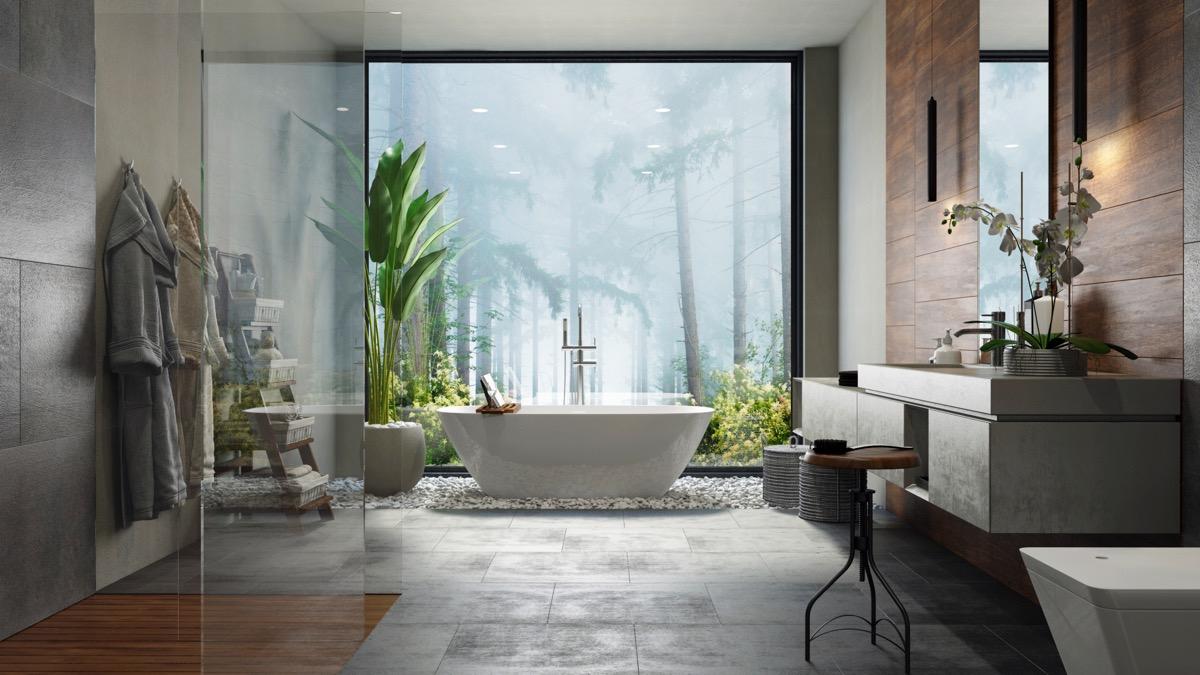 """Bức tranh khổ lớn phủ kín tường giúp đánh lừa thị giác, """"nới rộng"""" không gian phòng tắm."""