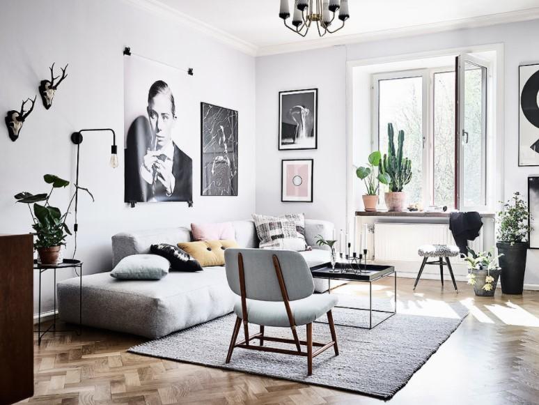 Thiết kế phòng khách Scandinavia sử dụng nhiều tranh ảnh đen-trắng kết hợp màu hồng pastel