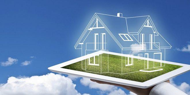 một bàn tay cầm đang đỡ mô hình ngôi nhà, biểu tượng cho ngôi nhà hình thành trong tương lai