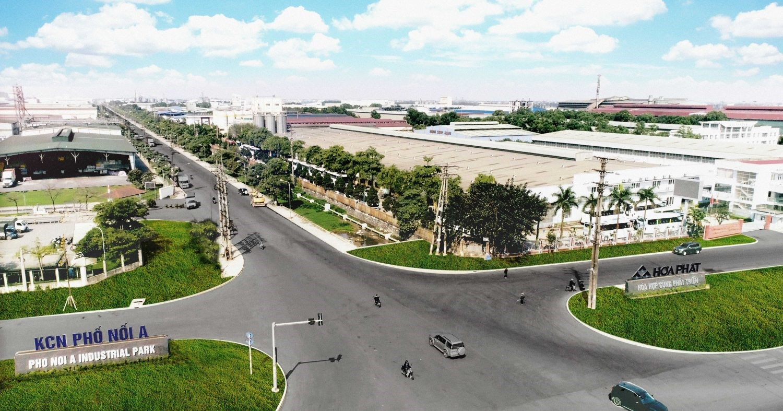 khu công nghiệp với nhiều nhà máy, đường đi và cây xanh