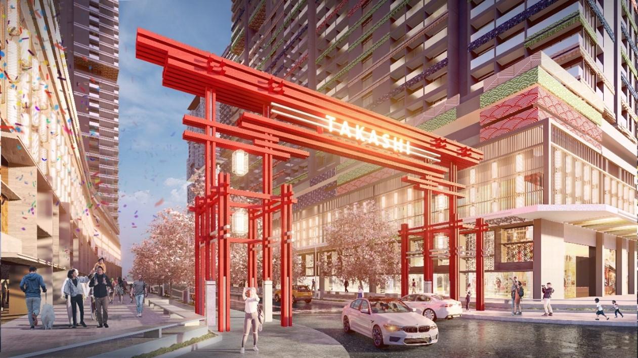 cổng vào màu đỏ nằm giữa 2 toà nhà