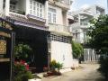 Nhà phố 1T 1L 2PN sau lưng Coop Mart Quận 9, cuối đường Quang Trung có sân đỗ xe mới xây 1 năm ruỡi