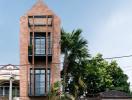 Ngôi nhà 3 tầng gạch mộc đậm chất làng quê Việt