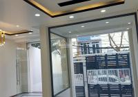 Cho thuê tòa nhà MT kinh doanh P. Linh Xuân, TP Thủ Đức nhà 1 tầng hầm, 4 tầng trên, LH 0906697386