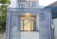 Bán nhà KDC Hóa An, DT 100m2, thổ cư 100%, 1 trệt 1 lầu, 4PN, sân ô tô, đường 6m, SHR, LH chính chủ