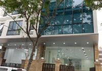 Cho thuê tòa nhà 8 tầng MP Vũ Tông Phan, DT 100m2/ sàn, thông sàn, có hầm, thang máy. Giá 80tr/th