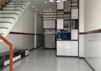 Nhà trệt 2 lầu 4pn mặt tiền dx49 Phú Mỹ cách HLV 500m Dt 80m tc 60m đường nhựa thông kế bên chợ