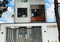 Bán nhà 1 trệt 3 lầu mặt tiền kinh doanh Nguyễn Tri Phương, Thủ Dầu Một 4 PN + 3wc đường nhựa 12m