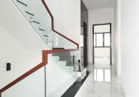 Bán nhà đường 25A, p. Tân Quy, hầm, 4 lầu, sân thượng