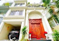 Cần bán gấp biệt thự sân vườn đường Nguyễn Trọng Tuyển, DT: 10m x 20m (200m2 đất)