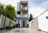 Nhà mặt tiền DX phường Phú Mỹ, đối diện cafe Happy, 2 lầu 1 trệt vuông vức, nội thất đủ sân xe hơi