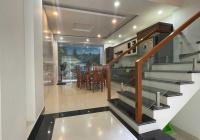 Cho thuê nhà riêng phố Văn Cao ô tô đỗ cửa nhà mới, 4 phòng ngủ