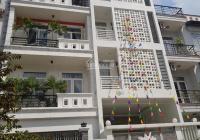 Cho thuê nhà 1 hầm 1 trệt 3 lầu sân thượng MT đường Nguyễn Quý Đức