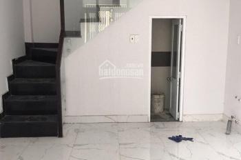 Cần bán nhà mới hẻm xe hơi Bùi Văn Ba. DTSD 118m2, 1 trệt, lửng, 2 lầu, ST, giá 2.2 tỷ