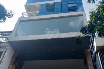 Bán nhà ngay phố Hoàng Cầu, Đống Đa, 100m2 x 7 tầng thang máy MT 7m, giá 35 tỷ đường 10m, hè 5m