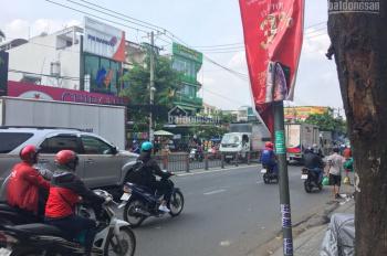 Cho thuê nhà MT Quang Trung, Gò Vấp, DT: 12m*32m, trống suốt (ngay chợ Hạnh Thông Tây)