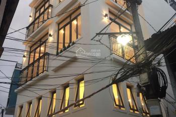 Bán nhà 4 lầu đường Trần Hưng Đạo, DT: 6m x 14m, 5PN + 5WC, giá: 9.9 tỷ