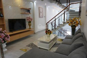 nhà phố quận 12, cách chợ 200m, 1 trệt 1 lửng 3 lầu, giá cực rẻ, thích hợp đầu tư và mua để ở.
