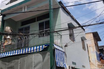Nhà bán HXH góc 2 MT 243/2 Tôn Đản, P. 15, Quận 4