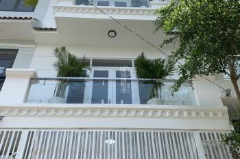 Chính chủ - Nhà mới xây DT: 4.6m x 12m, 2 lầu, sân thượng, hẻm xe hơi 7m đường Huỳnh Tấn Phát