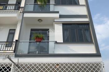 Chính chủ - Nhà mới xây góc 2 mặt tiền DT: 5m x 10m, 2 lầu, sân thượng, HXH 2177 Huỳnh Tấn Phát