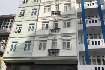 Cho thuê nhà nguyên căn DTSD 320m2 MT đường hẻm lớn CMT8, P5, Tân Bình, 4x18m. Nhà 4 lầu hầm