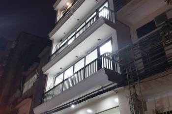 Cho thuê nhà mặt ngõ 9 Hoàng Cầu DT 60m2 x 6.5 tầng, mặt tiền 7m, nhà mới, có TM, giá 55 triệu