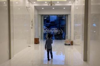 Cho thuê nhà 2 mặt tiền Huỳnh Văn Bánh - Phú Nhuận. (4.5x20m), 6 tầng, thang máy, nhà mới xây