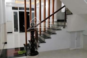 Nhà trệt 2 lầu, 4 phòng ngủ, nhà rất mới cạnh công viên khu Tân Quy Đông. LH 0903.317.456