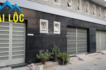 Cho thuê nhà đường Phan Đình Giót, đoạn sầm uất nhất, DT 8x30m, nhà 3 lầu, có bãi đậu xe rộng