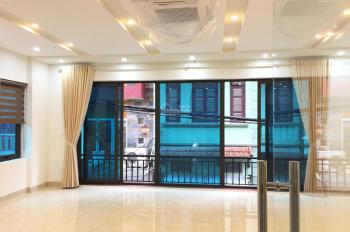 Bán tòa nhà VP MP Vũ Ngọc Phan, Nguyên Hồng, Đống Đa, 80m2x7tầng, thang máy, 2 mặt đường, 21 tỷ