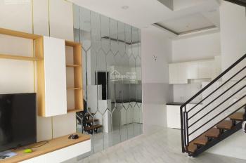 Chính chủ bán gấp nhà mặt tiền gần nhà văn hóa Thạnh Lộc. 1 trệt 2 lầu, LH: 0931.811.412