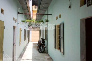 Cần bán gấp nhà trọ 16p, DT 300m2, sổ hồng riêng, giá 1,5 tỷ đường Quang Trung thị trấn Hóc Môn