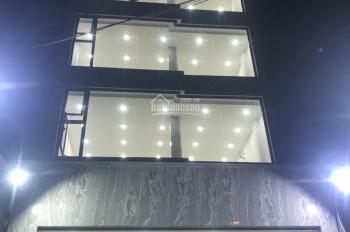 Nhà văn phòng 6x18m, 4 lầu thang máy mặt tiền Trịnh Đình Trọng, P. Phú Trung, Q.Tân Phú